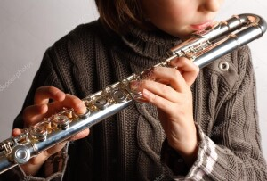 depositphotos_32517939-stock-photo-girl-playing-flute